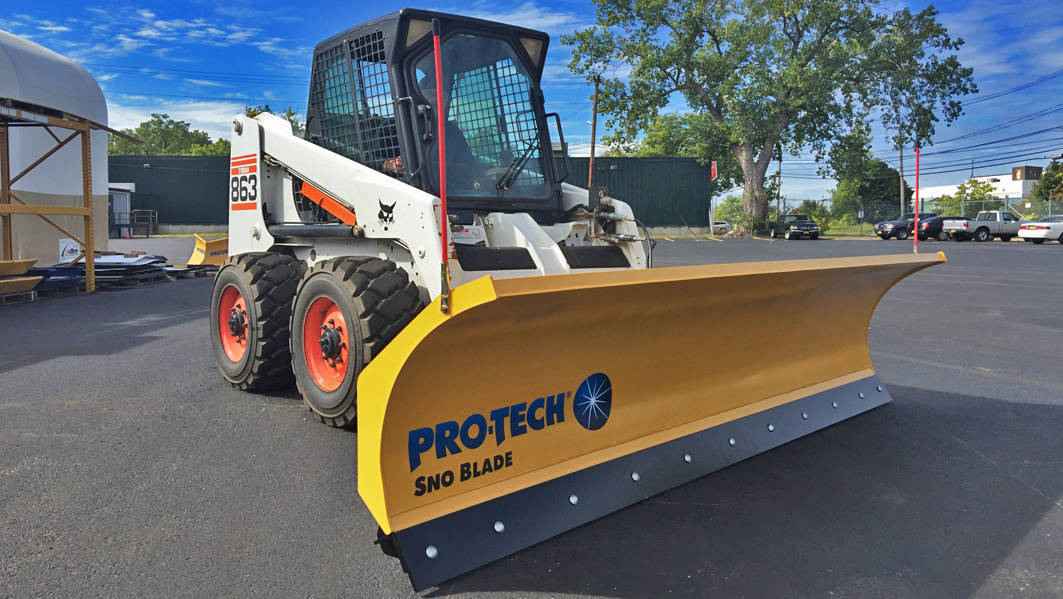 skidsteer with sno blade
