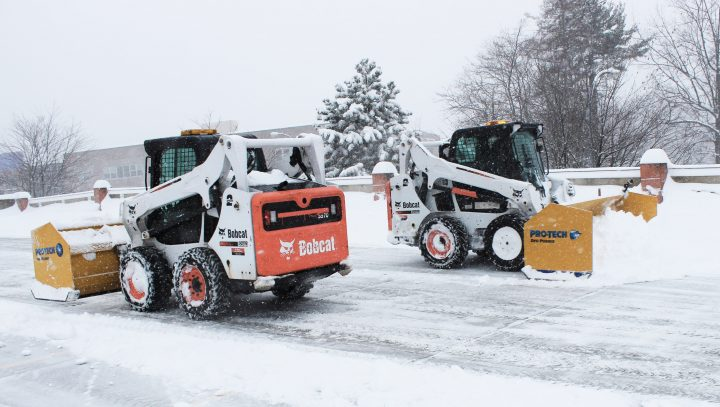 skidsteer with sno pushers