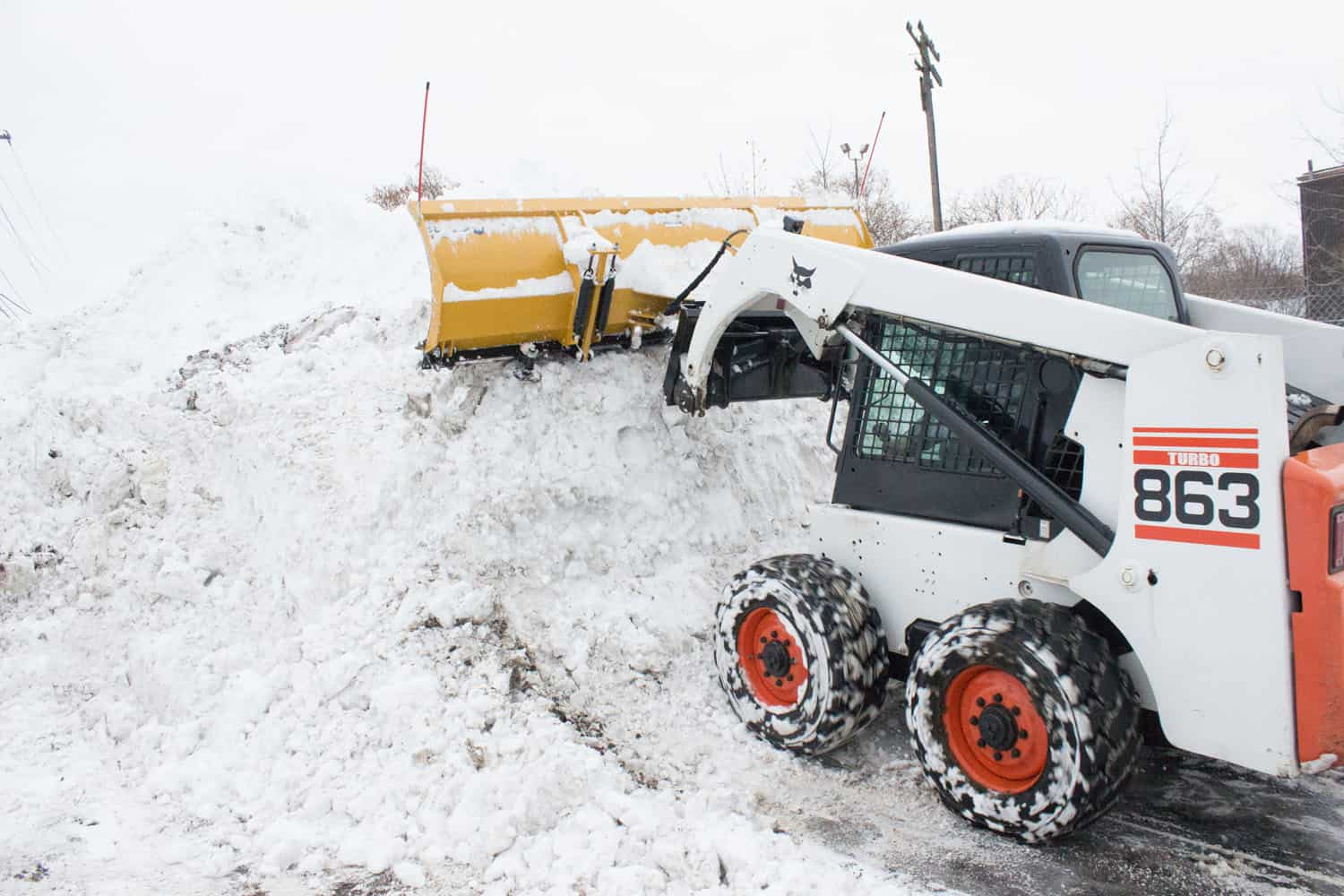 skidsteer pushing snow
